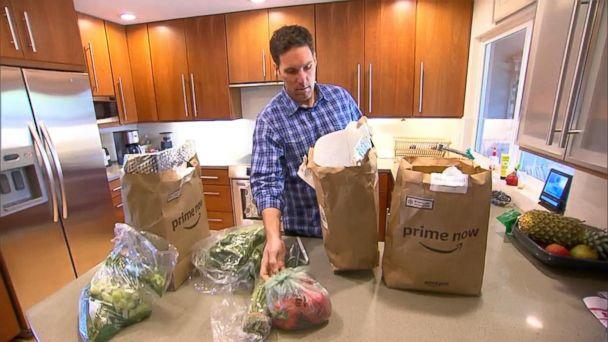 PHOTO: Steve Enders unpacks produce from an Amazon Prime Now grocery delivery order for 'GMA.' (ABC News)