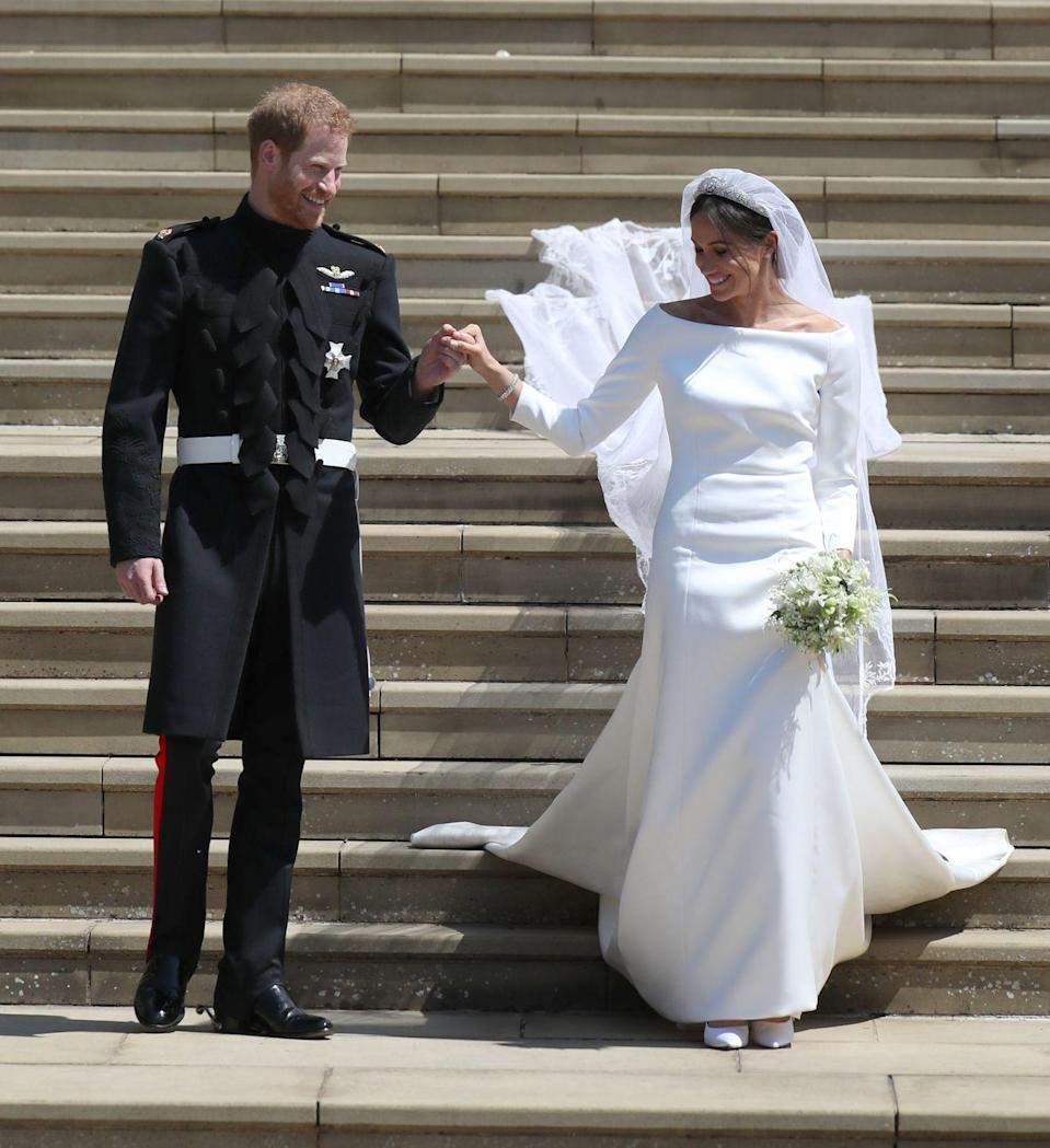 <p>In May 2018, Prince Harry and Meghan Markle tied the knot in St George's Chapel at Windsor Castle. Markle wore a Givenchy gown designed by British designer Clare Waight Keller. The ceremony was reportedly viewed by hundreds of millions of people around the world.</p>