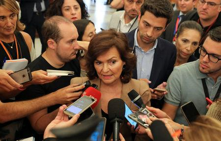 "Spain's deputy prime minister Carmen Calvo speaks to journalists at parliament before a vote on the Socialist's government's plans to move the remains of former dictator Francisco Franco from the giant mausoleum at ""The Valley of the Fallen"",  in Madrid, Spain, September 13, 2018.  REUTERS/Sergio Perez"