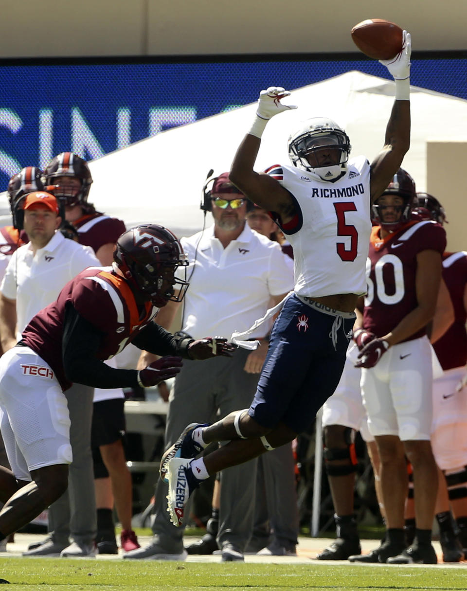 Richmond's Jasiah Williams (5) attempts to make a one handed catch in the first half of the Richmond Virginia Tech NCAA college football game in Blacksburg, Va., Saturday, Sept. 25 2021. (Matt Gentry/The Roanoke Times via AP)