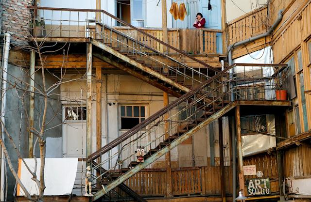 <p>Iron stairs and wooden balconies are seen in a courtyard in the old town, Tbilisi, Georgia, April 4, 2017. (Photo: David Mdzinarishvili/Reuters) </p>
