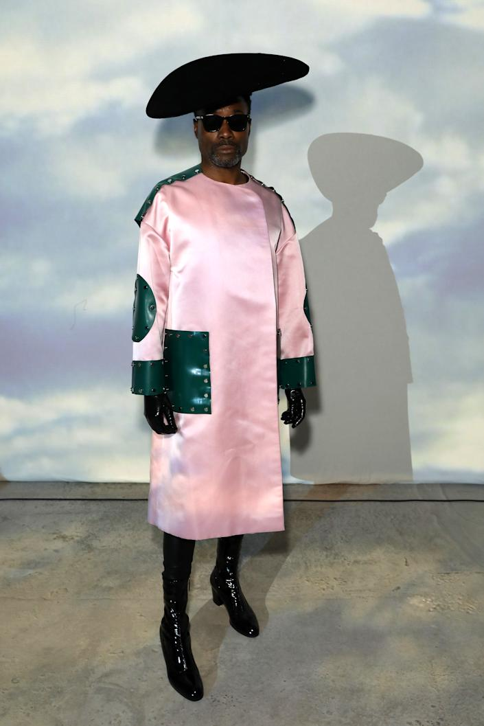 Billy Porter attended the Christopher Kane show wearing a baby pink and forrest green coat and black accessories [Photo: Getty Images]