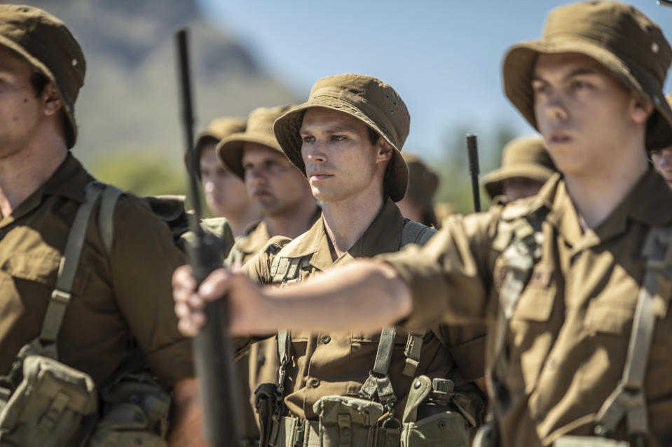 "This image released by IFC Films shows Kai Luke Brummer, center, in a scene from ""Moffie."" (IFC Films via AP)"