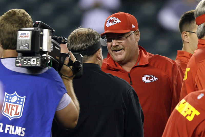 Kansas City Chiefs coach Andy Reid, right, meets with Philadelphia Eagles coach Chip Kelly before an NFL football game, Thursday, Sept. 19, 2013, in Philadelphia. (AP Photo/Matt Rourke)