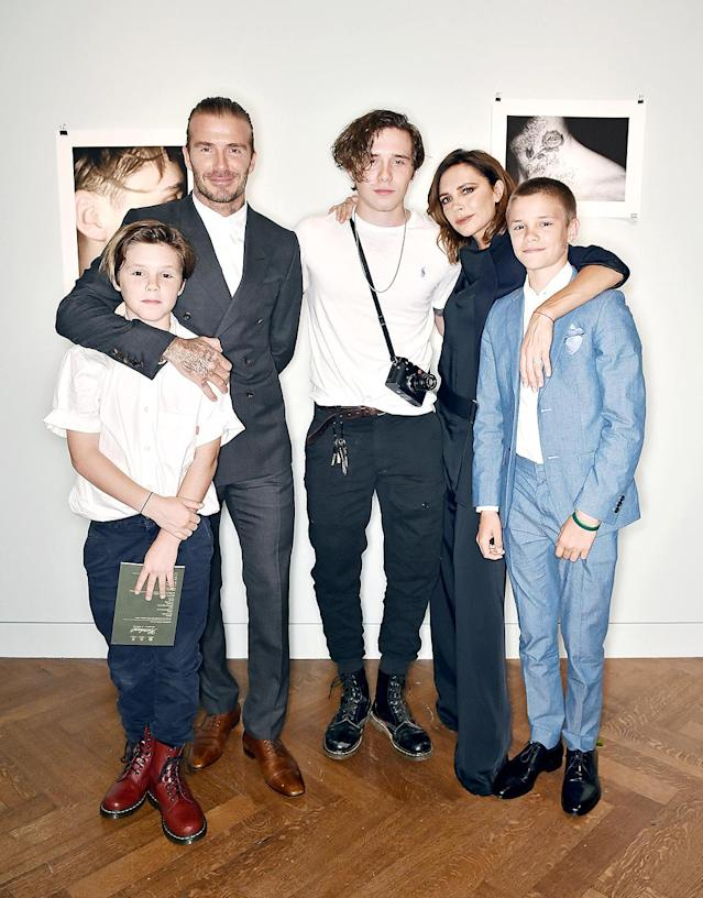 <p>David and Victoria Beckham were super proud of their eldest son, Brooklyn, as he unveiled his photography book, <i>What I See</i>, in London. His brothers, Cruz and Romeo, were also there to cheer him on. (Photo: Nick Harvey/REX/Shutterstock) </p>