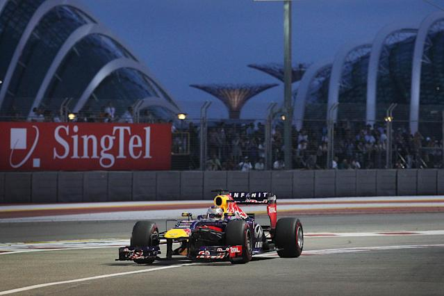 Red Bull driver Sebastian Vettel of Germany steers his car back into the pit during the third practice session for the Singapore Formula One Grand Prix on the Marina Bay City Circuit in Singapore, Saturday, Sept. 21, 2013. (AP Photo/Wong Maye-E)