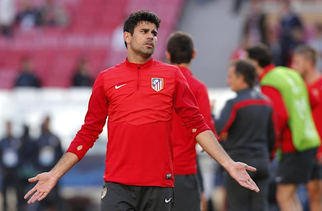 Atletico's Diego Costa gestures, during a training session ahead of Saturday's Champions League final soccer match between Real Madrid and Atletico Madrid, in Luz stadium in Lisbon, Portugal, Friday, May 23, 2014. (AP Photo/Daniel Ochoa de Olza)