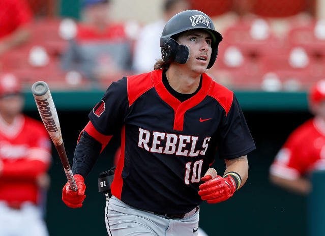 FILE - In this Sunday, May 5, 2019, file photo, UNLV's Bryson Stott (10) watches the ball during an NCAA college baseball game against the University of Houston, in Houston. Stott is ready to follow in the footsteps of superstars Kris Bryant and Bryce Harper, as the next major-league hit from southern Nevada. The UNLV junior is projected to go in the first round of June's MLB Draft, and it's the All-American candidate shortstop's humility that might be his most impressive trait. (AP Photo/Aaron M. Sprecher, File)