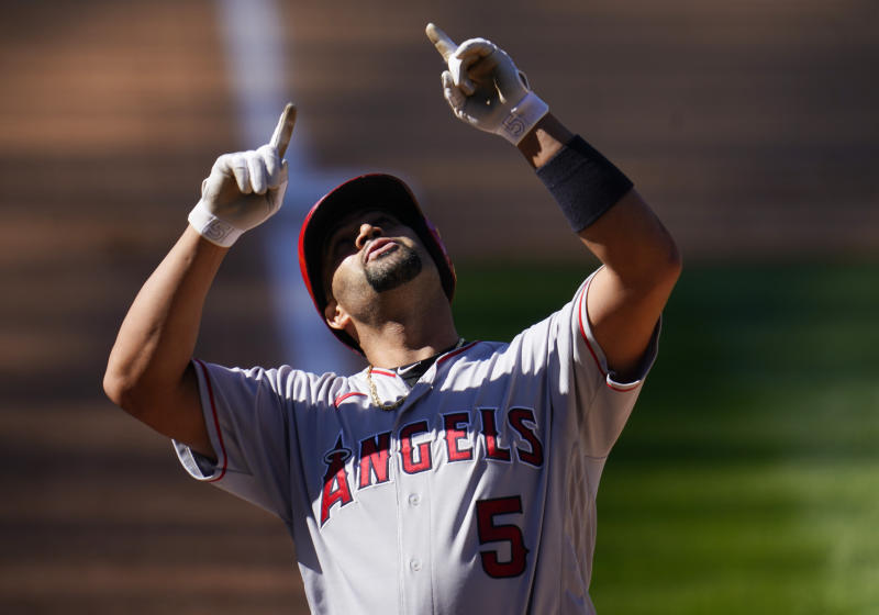 Los Angeles Angels' Albert Pujols gestures as he crosses home plate after hitting a two-run home run off Colorado Rockies relief pitcher Carlos Estevez in the eighth inning of a baseball game Sunday, Sept. 13, 2020, in Denver. (AP Photo/David Zalubowski)