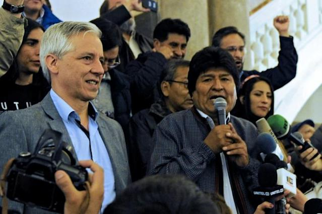 Evo Morales welcomed his first-round win in the Bolivian presidential election, telling cheering crowds 'we have won again, really, it is something historical, unforgettable' (AFP Photo/JORGE BERNAL)