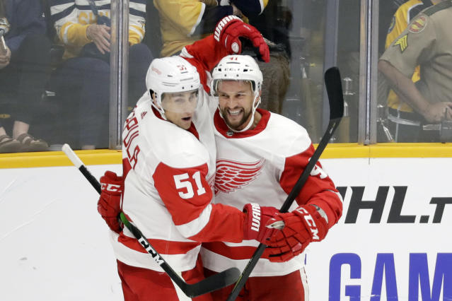 Detroit Red Wings center Luke Glendening (41) is congratulated by Valtteri Filppula (51), of Finland, after scoring against the Nashville Predators during the third period of an NHL hockey game Saturday, Oct. 5, 2019, in Nashville, Tenn. (AP Photo/Mark Humphrey)