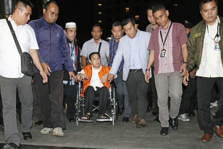 Indonesia's parliament speaker was moved in a wheelchair from hospital to a detention centre after being charged for his involvement in a graft scandal