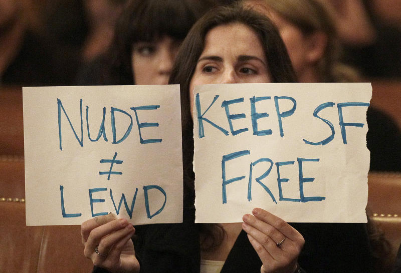 Taylor Whitfield holds up a sign protesting the Board of Supervisors proposal to ban public nakedness at City Hall in San Francisco, Tuesday, Nov. 20, 2012. San Francisco lawmakers on Tuesday narrowly approved a proposal to ban public nakedness, rejecting arguments that the measure would eat away at a reputation for tolerance enjoyed by a city known for flouting convention and flaunting its counter-culture image. The 6-5 Board of Supervisors vote means that exposed genitals will be prohibited in most public places, including streets, sidewalks and public transit. (AP Photo/Jeff Chiu)