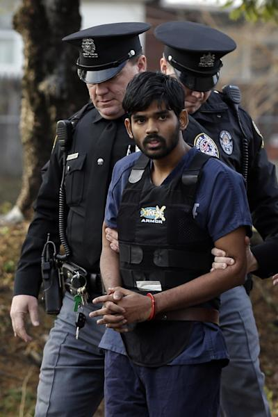 Raghunandan Yandamuri is escorted to a Montgomery County district court for a preliminary hearing Wednesday, Nov. 28, 2012, in Bridgeport, Pa. Investigators said Yandamuri killed 10-month-old Saanvi Venna and her grandmother Satyavathi Venna in a botched ransom kidnapping. He is being held without bail on murder, kidnapping and other charges. (AP Photo/Matt Rourke)