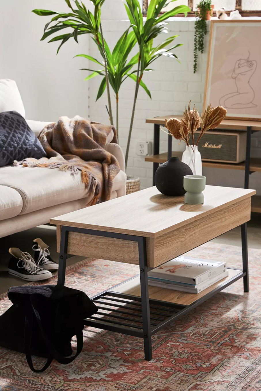 """<h2>Coffee Tables<br></h2><br><h3>Urban Outfitters Kirby Pop-Up Coffee Table</h3><br>Coffee tables may be <em>the</em> furniture benchmark for adulthood. For a piece that you'll be using every day, they are essential and therefore worth saving up to splurge on a quality one — like this top-rated wood style with a pop-up top and bonus interior storage.<br><br><em>Shop <a href=""""https://www.urbanoutfitters.com/shop/kirby-pop-up-coffee-table"""" rel=""""nofollow noopener"""" target=""""_blank"""" data-ylk=""""slk:Urban Outfitters"""" class=""""link rapid-noclick-resp""""><strong>Urban Outfitters</strong></a></em><br><br><strong>Urban Outfitters</strong> Kirby Pop-Up Coffee Table, $, available at <a href=""""https://go.skimresources.com/?id=30283X879131&url=https%3A%2F%2Fwww.urbanoutfitters.com%2Fshop%2Fkirby-pop-up-coffee-table"""" rel=""""nofollow noopener"""" target=""""_blank"""" data-ylk=""""slk:Urban Outfitters"""" class=""""link rapid-noclick-resp"""">Urban Outfitters</a>"""