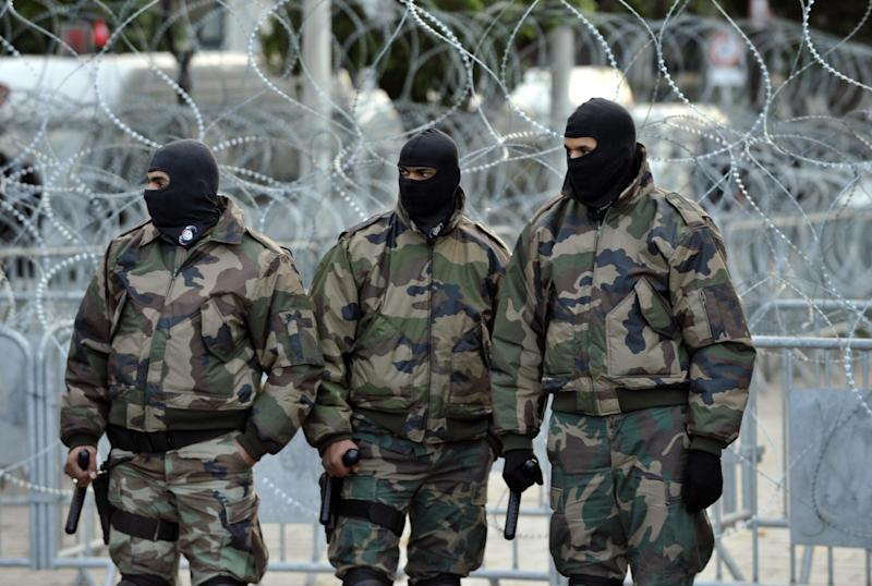Tunisian special security forces stand guard in Habib Bourguiba Avenue in Tunis on February 8, 2013