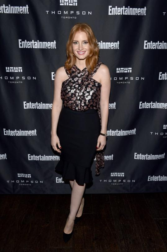 <p>Jessica Chastain was ready to party following press conferences and premieres in a Prabal Gurung dress with a gold criss-cross halter top and trumpet skirt at EW's Must List Party.</p>