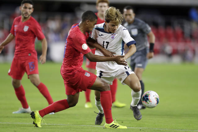 Cuba's Jean Carlos Rodriguez, right, and United States' Reggie Cannon compete for the ball during the first half of a CONCACAF Nations League soccer match Friday, Oct. 11, 2019, in Washington. (AP Photo/Julio Cortez)