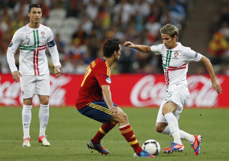 Portugal's Fabio Coentrao tries to go past Spain's Alvaro Arbeloa during the Euro 2012 soccer championship semifinal match between Spain and Portugal in Donetsk, Ukraine, Wednesday, June 27, 2012. (AP Photo/Matthias Schrader)