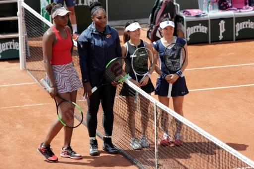 Little and large: Venus and Serena Williams tower over doubles opponents,  Miyu Kato and Shuko Aoyama of Japan