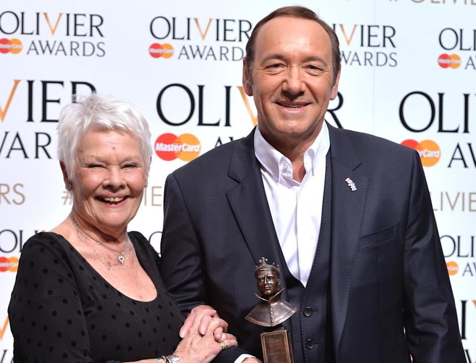Judi Dench and Kevin Spacey at<span> the Olivier Awards in April 2015.</span> (Photo: Anthony Harvey/Getty Images)