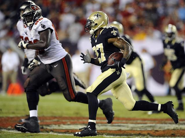 New Orleans Saints free safety Malcolm Jenkins (27) heads upfield after intercepting a pass by Tampa Bay Buccaneers quarterback Josh Freeman during the third quarter of an NFL football game on Sunday, Sept. 15, 2013, in Tampa, Fla. (AP Photo/Brian Blanco)