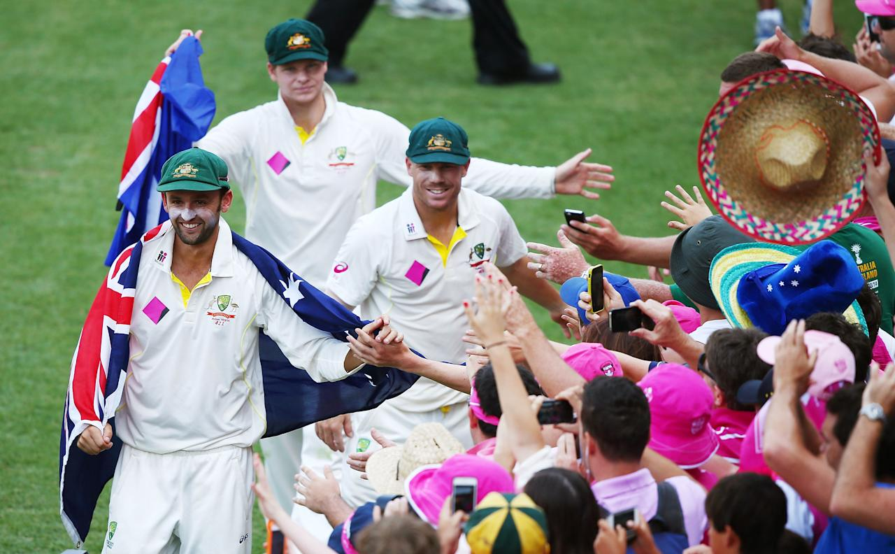 SYDNEY, AUSTRALIA - JANUARY 05:  (L-R) Nathan Lyon, Steve Smith and David Warner of Australia celebrate with the crowd after winning the test and the series 5-0 during day three of the Fifth Ashes Test match between Australia and England at Sydney Cricket Ground on January 5, 2014 in Sydney, Australia.  (Photo by Matt King/Getty Images)