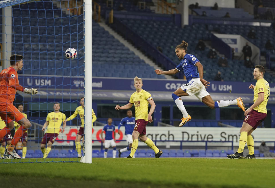 Everton's Dominic Calvert-Lewin, second right, scores his side's opening goal during the English Premier League soccer match between Everton and Burnley at Goodison Park in Liverpool, England, Saturday, March 13, 2021. (AP Photo/Jon Super, Pool)