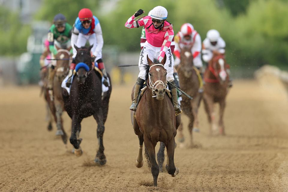 BALTIMORE, MARYLAND - MAY 15: Jockey Flavien Prat #6 riding Rombauer celebrates as he wins the 146th Running of the Preakness Stakes at Pimlico Race Course on May 15, 2021 in Baltimore, Maryland. (Photo by Patrick Smith/Getty Images)
