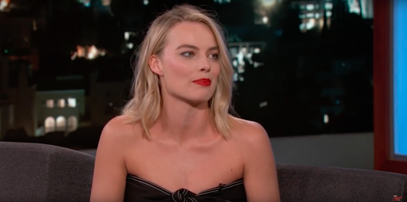 Margot Robbie looked stunning in a black strapless dress and red-lipstick. Source: Supplied