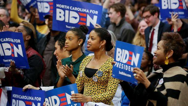 PHOTO: People wave campaign signs during an event with Democratic presidential candidate and former U.S. Vice President Joe Biden at Saint Augustine's University in Raleigh, N.C., Feb. 29, 2020. (Elizabeth Frantz/Reuters)