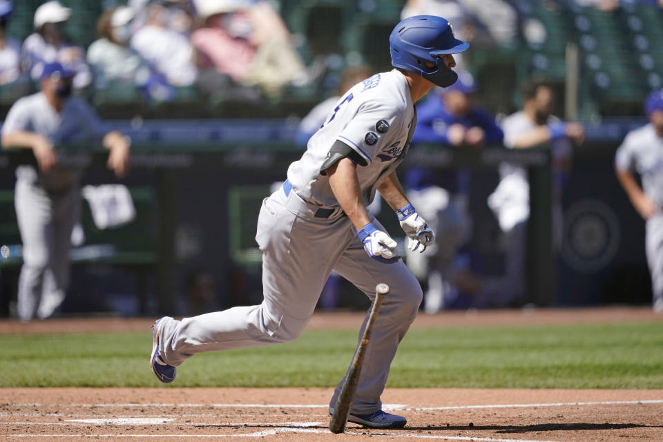 Los Angeles Dodgers' Corey Seager watches the path of his hit as he singles in a run against the Seattle Mariners in the third inning of a baseball game Tuesday, April 20, 2021, in Seattle. (AP Photo/Ted S. Warren)