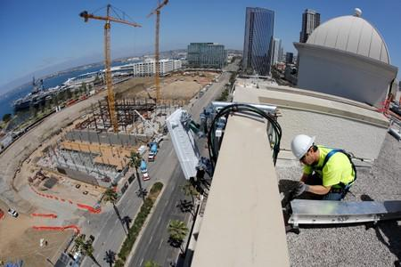 FILE PHOTO: Telecommunications worker Chris Viens installs a new 5G antenna system for AT&T's 5G wireless network in downtown San Diego