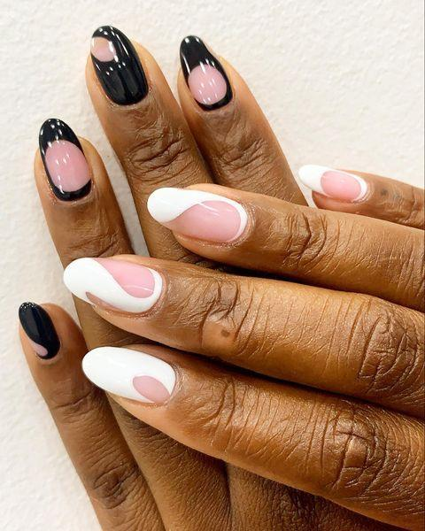 """<p>Retro aesthetics is a big mood this year, and the easiest way to nail the look in a mani is to lean into classy B&W designs. </p><p>Throw in abstract shapes and a high gloss finish, and you're onto a total winner.</p><p><a href=""""https://www.instagram.com/p/CFAQYdTnTn9/"""" rel=""""nofollow noopener"""" target=""""_blank"""" data-ylk=""""slk:See the original post on Instagram"""" class=""""link rapid-noclick-resp"""">See the original post on Instagram</a></p>"""