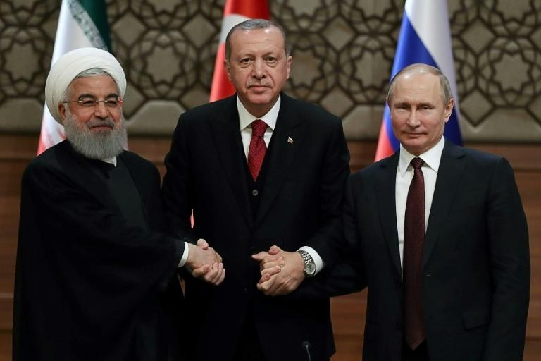 The three main power brokers in Syria, (LtoR) Iran's Hassan Rouhani, Turkey's Recep Tayyip Erdogan and Russia's Vladimir Putin, seen here in Ankara on April 4, 2018, are to hold talks in Tehran on Friday on the fate of the last rebel bastion Idlib