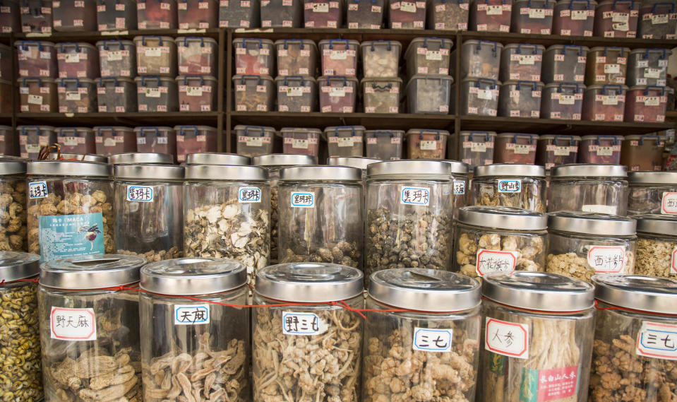 Traditional Chinese medicine in jars and boxes.