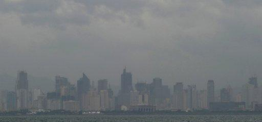 File photo shows downtown Manila shrouded in cloud and haze during bad weather in October. A powerful typhoon barrelled towards the Philippines Monday, prompting authorities to order the immediate evacuation of thousands of people from coastal and low-lying areas, officials said