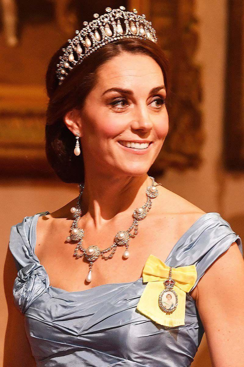 """<p>The Duchess of Cambridge <a href=""""https://www.harpersbazaar.com/celebrity/latest/a24119492/kate-middleton-tiara-necklace-dress-netherlands-state-dinner/"""" rel=""""nofollow noopener"""" target=""""_blank"""" data-ylk=""""slk:attended a State Banquet dinner"""" class=""""link rapid-noclick-resp"""">attended a State Banquet dinner</a> at Buckingham Palace with a twisted updo that let the Lover's Knot tiara shine. </p>"""
