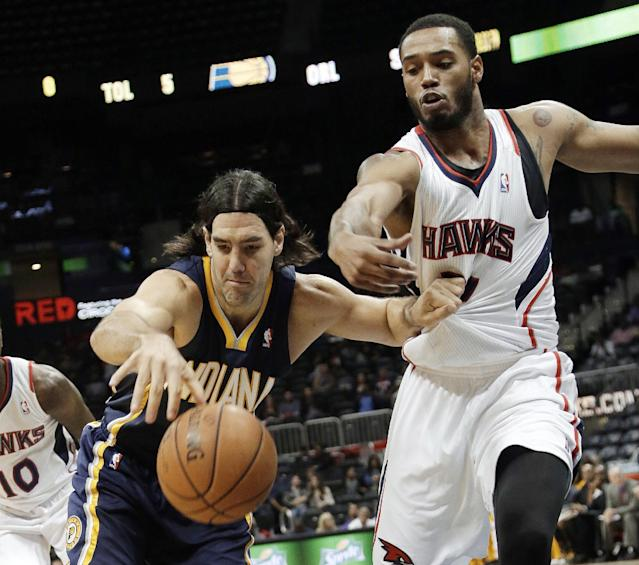 Indiana Pacers power forward Luis Scola (4), of Argentina, drives against Atlanta Hawks power forward Mike Scott (32) during the first half of a preseason NBA basketball game Tuesday, Oct. 22, 2013, in Atlanta. (AP Photo/John Bazemore)