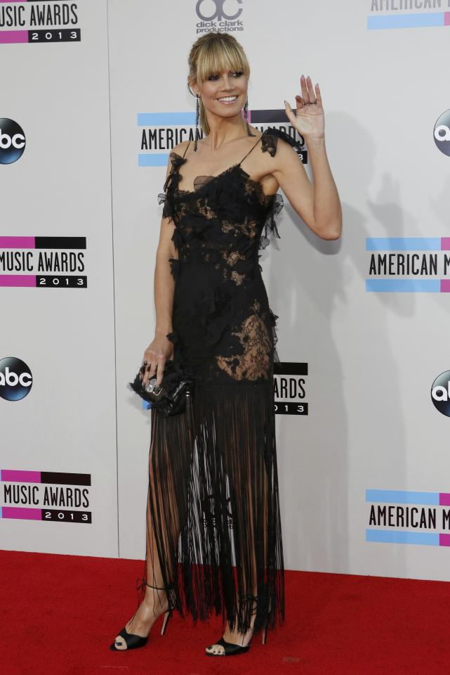 Supermodel Heidi Klum arrives at the 41st American Music Awards in Los Angeles, California November 24, 2013. REUTERS/Mario Anzuoni (UNITED STATES - TAGS: ENTERTAINMENT)(AMA-ARRIVALS)