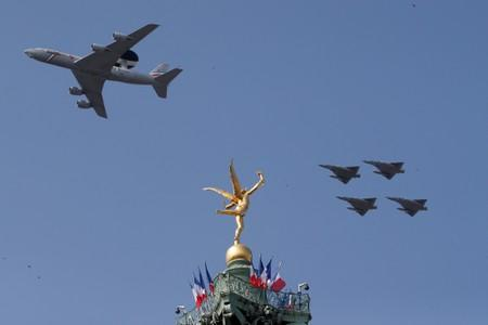 "FILE PHOTO: A Boeing AWACS 1E-3F and Mirage 2000 jet fighters fly past the ""Genie de la Liberte""gilded figure (Spirit of Freedom) on top of the Place de la Bastille's July Column in Paris"