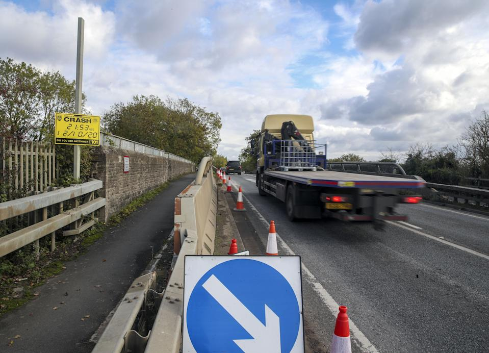 A police witness appeal sign on the A40 near Oxford where a four-year-old girl, a six-year-old boy, an eight-year-old girl and a 29-year-old woman from Chinnor, Oxfordshire, died Monday night after a collision between a people carrier and a heavy goods vehicle.