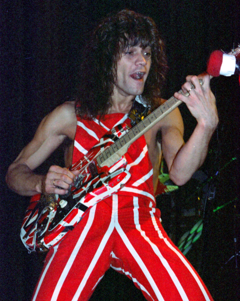 **FILE PHOTO** Eddie Van Halen Has Passed Away at 65 from Cancer. NEW YORK, NY - OCTOBER 8: Eddie Van Halen of Van Halen performs on the Diver Down tour at Madison Square Garden on October 8, 1982. Credit: mpi04 / Media Punch Inc. ***NO FRANCE***. /IPX