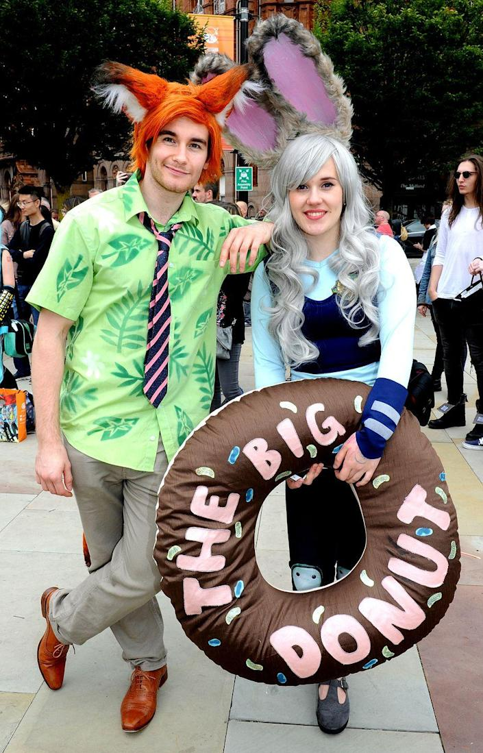 """<p>Get in touch with your wild side by dressing up as Nick Wilde and Judy Hopps from <em>Zootopia</em>. </p><p><a class=""""link rapid-noclick-resp"""" href=""""https://www.amazon.com/APTRO-Hawaiian-Regular-Tropical-Monstera/dp/B07MC6ZL36?tag=syn-yahoo-20&ascsubtag=%5Bartid%7C10070.g.1923%5Bsrc%7Cyahoo-us"""" rel=""""nofollow noopener"""" target=""""_blank"""" data-ylk=""""slk:SHOP GREEN SHIRT"""">SHOP GREEN SHIRT</a></p><p><a class=""""link rapid-noclick-resp"""" href=""""https://www.amazon.com/Reflective-Pockets-Visibility-Tape%EF%BC%88Blue-Medium%EF%BC%89/dp/B07F6Y7H1Y?tag=syn-yahoo-20&ascsubtag=%5Bartid%7C10070.g.1923%5Bsrc%7Cyahoo-us"""" rel=""""nofollow noopener"""" target=""""_blank"""" data-ylk=""""slk:SHOP BLUE VEST"""">SHOP BLUE VEST</a></p>"""