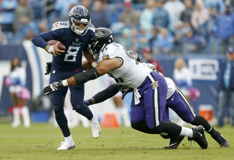Ravens get more sacks than Marcus Mariota has completions in Baltimore shutout