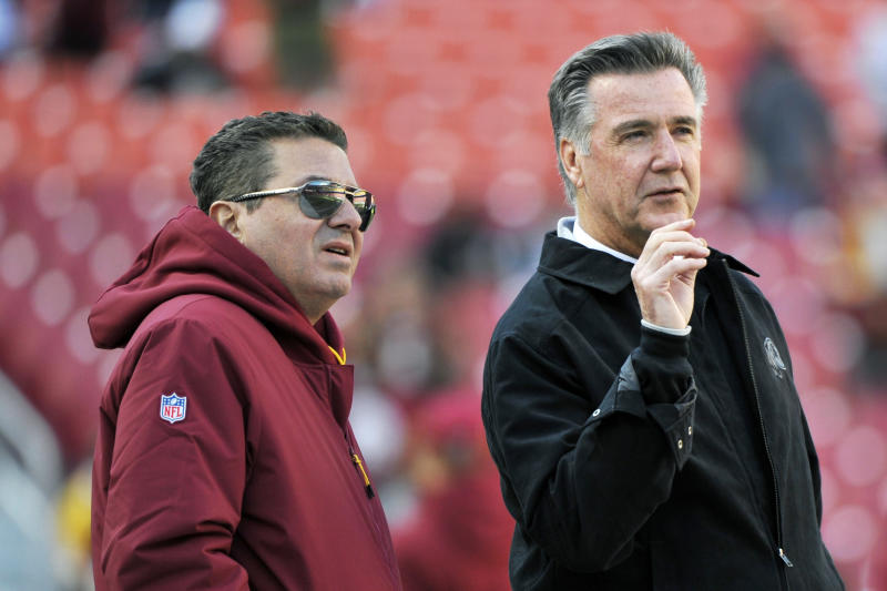 Washington Redskins owner Dan Snyder, left, fired longtime team president Bruce Allen after another losing season. (AP Photo/Mark Tenally, File)