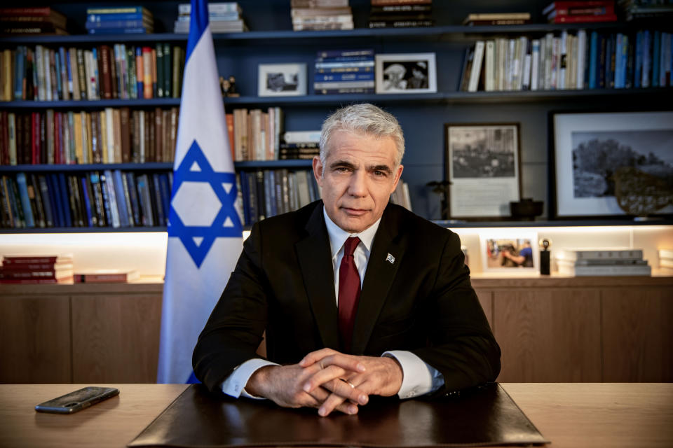 In this Thursday, May 21, 2020 file photo, Israel's opposition leader Yair Lapid poses for a photo at his office in Tel Aviv, Israel, Thursday, May 21, 2020. Israel's President Reuven Rivlin has tapped Lapid to form a new government, a step that could lead to the end of the lengthy rule of Prime Minister Benjamin Netanyahu. Rivlin announced his decision on live television a day after Netanyahu failed to cobble together a governing coalition by a midnight deadline. (AP Photo/Oded Balilty, File)