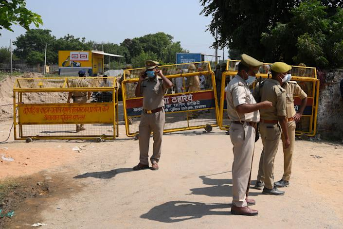 "Police barricading on the way to the home of the victim in the Hathras gang rape case on October 1, 2020 in Hathras, India. <span class=""copyright"">Amal KS—Hindustan Times/Getty Images</span>"