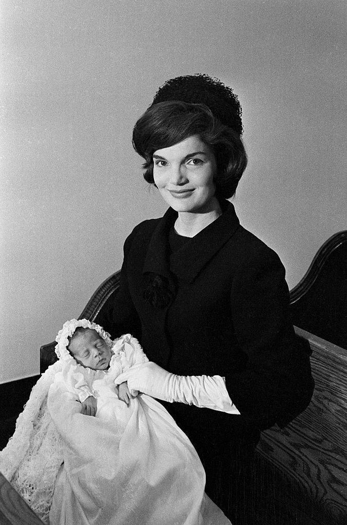 <p>Jackie with her newborn son, John F. Kennedy Jr., at his christening in Georgetown. </p>