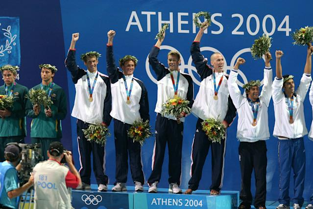 USA (Michael Phelps, Ryan Lochte, Peter Vanderkaay,Klete Keller) beat Australia and win gold in the Men's 4x200m Freestyle Relay in a time of 7:07.33 Michael Phelps collects his second gold of the night. (Photo by Chris Ivin/WireImage)